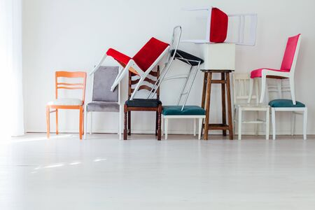 lots of chairs against the wall in the interior of the white office