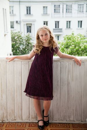 Photo pour Portrait of a beautiful girl 10 years old in a dark dress - image libre de droit