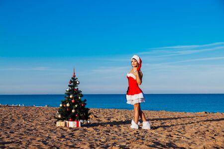 Photo pour new year Christmas tree Beach Resort Sea girl - image libre de droit
