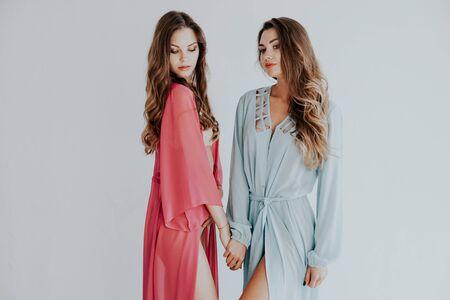 Photo pour two women hold hands fashion portrait nice - image libre de droit