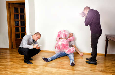 Murder scene with two forensic analysts investigating a crime