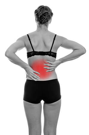Rear view of young woman with spinal pain. Isolated on white. Black and white