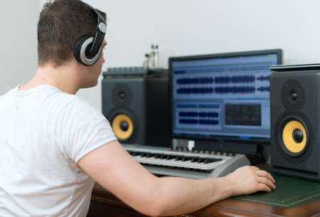 Photo for Male sound producer working in recording studio. - Royalty Free Image
