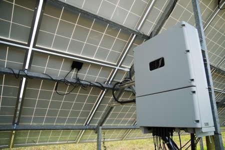 Photo pour Inverter behind the solar panels. Renewable energy. - image libre de droit