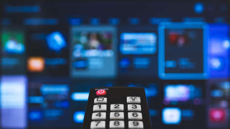 Photo for Remote control pointing on Smart TV. - Royalty Free Image