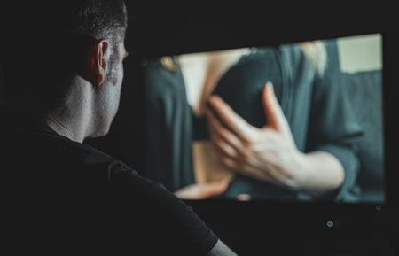 Photo pour Man watching erotic film late at night. - image libre de droit