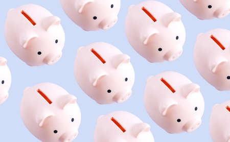 Photo pour Pattern of pink piggy banks top view on gray background - image libre de droit