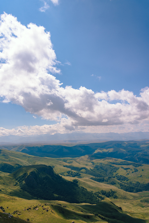 Photo pour View from the Bermuty Plateau on a summer day. Hills and clouds in the distance. - image libre de droit