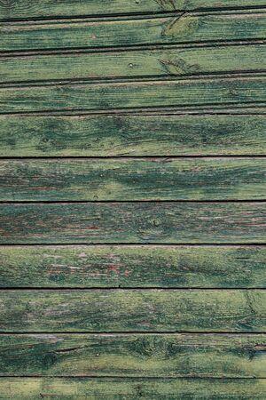 Foto de Macro texture of a wooden fence with cracked green paint. - Imagen libre de derechos