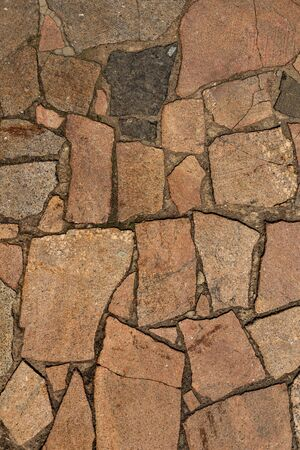 Photo for The texture of the sidewalk of chaotic granite stones of different colors with many cracks - Royalty Free Image