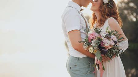Foto de the bride and groom on the background of a mountain stream - Imagen libre de derechos