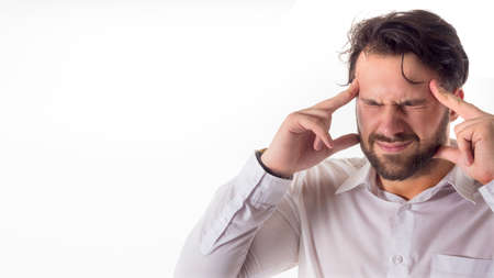 Crisis concept: Overburdened businessman closed eyes with both hands at head and shouting isolated on white background.