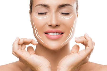 Photo pour Face lift treatment anti aging skincare woman concept. Woman touching face with lifting lines on white background. - image libre de droit