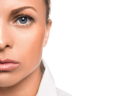 Photo for Close up portrait of a serious woman. Half of face and copy space. - Royalty Free Image