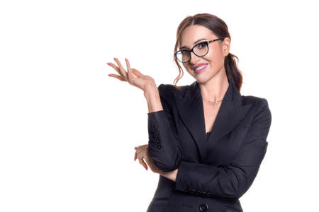 Photo pour Smiley businesswoman in eyeglasses showing by hand on your product. - image libre de droit