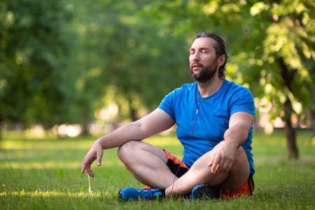 Photo for Middle aged bearded man in lotus pose outdoor. - Royalty Free Image