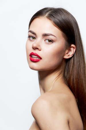 Photo pour Brunette naked shoulders red lips attractive look studio clear skin - image libre de droit