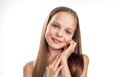 Photo for Cheerful girl in a white T-shirt smile long hair close-up light background cropped - Royalty Free Image