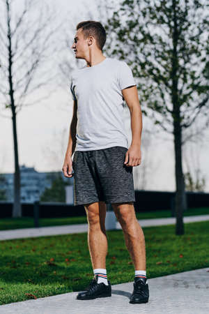 Photo for A man in shorts goes in for sports in a park in nature and a model running sneakers - Royalty Free Image