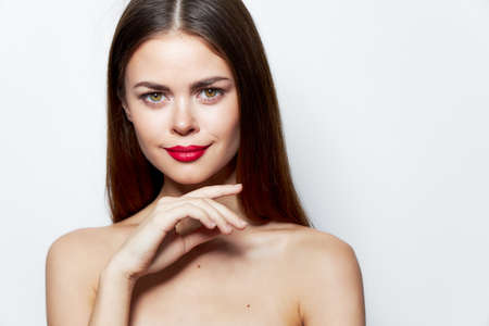 Photo pour Charming woman Nude shoulders smile red lips cropped view skin care - image libre de droit