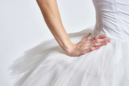 Photo pour Ballerina in white tutu elegant dance performed sensuality silhouette light background - image libre de droit