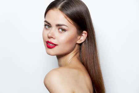 Photo pour Woman portrait Smile red lips bared shoulders bright makeup - image libre de droit