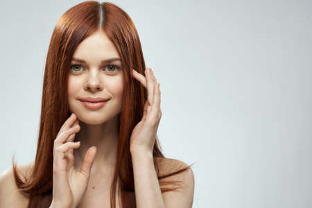 Photo pour Woman with beautiful long hair care nude shoulders cosmetics cropped view light background - image libre de droit