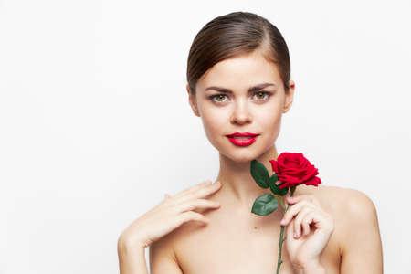 Photo pour Woman with flower Smiling naked shoulders model red lips - image libre de droit