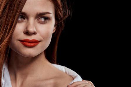 beautiful woman elegant style red lips unbuttoned white shirt close-up black background