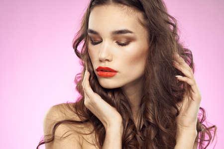 Foto de Woman with hairstyle and red lips naked shoulders bright makeup attractive look - Imagen libre de derechos