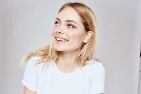 Photo for emotional blonde white t-shirt close-up studio lifestyle fun - Royalty Free Image