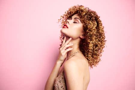 Photo pour Beautiful woman touches the neck with his hand fashionable clothes background - image libre de droit