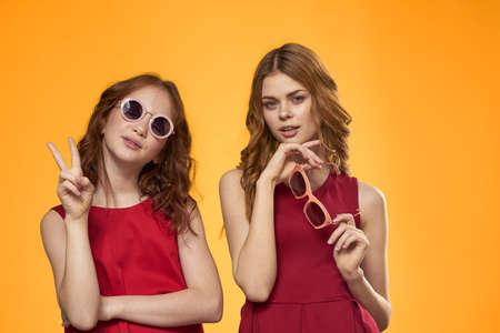 Foto per Mom and daughter fun moda Studio communication yellow background - Immagine Royalty Free