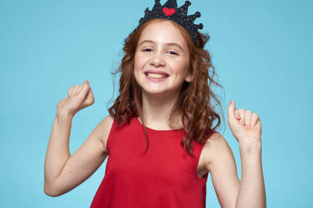 Photo for Girl in red dress with curly hair fun lifestyle blue background - Royalty Free Image