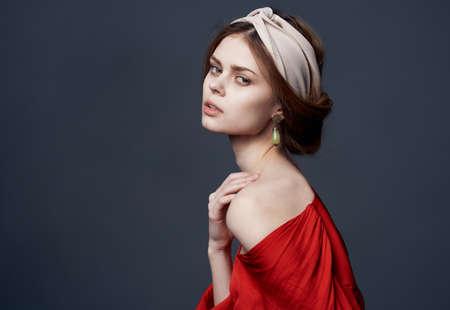 Photo pour Elegant woman red dress luxury glamor decoration attractive look - image libre de droit