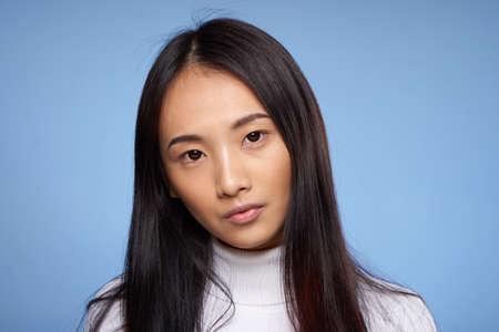 Photo pour pretty woman asian appearance attractive look cropped view blue background - image libre de droit
