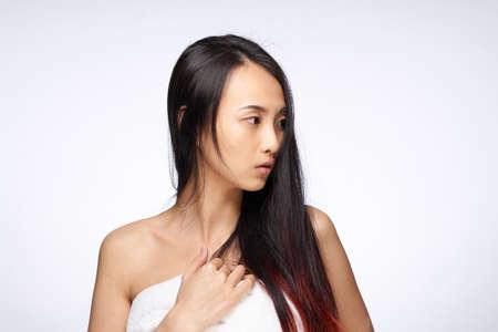 Photo pour asian woman loose hair towel on body bare shoulders hygiene - image libre de droit