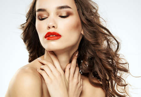 Photo pour Charming lady with closed eyes eyeshadows and bright makeup red lips - image libre de droit