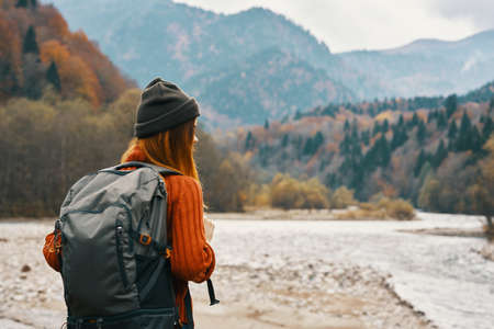 Photo for woman with a backpack near the river on nature in the mountains - Royalty Free Image