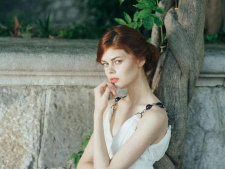 Photo pour Woman in white dress on nature Greece charm decoration model - image libre de droit