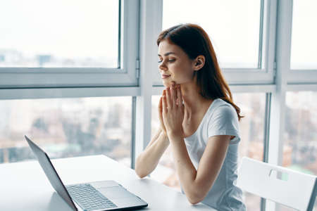 Photo pour woman at home at the table in front of laptop working office - image libre de droit
