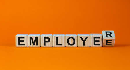 From an employee to an employer. Turned a cube and changed the word 'employee' to 'employer'. Beautiful orange background, copy space. Business concept.