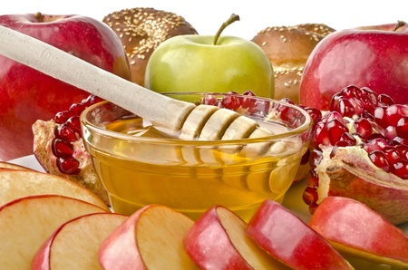 Still life closeup - challah, apples, pomegranate and bowl of honey, isolated over white. Illustration of Rosh Hashanah (jewish new year) or Savior of the Apple Feast Dayの写真素材