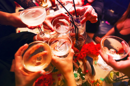 Photo pour Clinking glasses with alcohol and toasting, party - image libre de droit