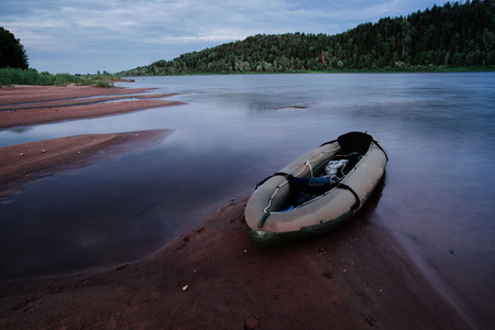 Rubber boat on the river in the late afternoon.