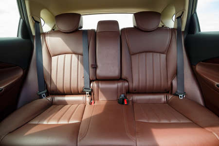 Photo pour Brown leather seats in the new car. Interior upholstery with genuine leather. - image libre de droit