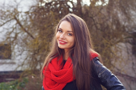 young beautiful girl in leather jacket smiling and looking in camera