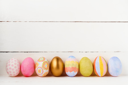 Decorated Easter eggs on white background with copy space
