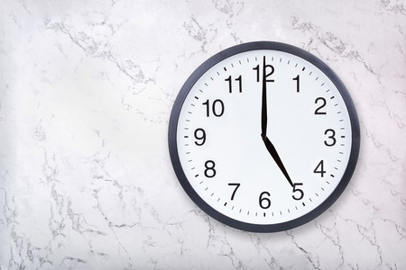 Photo for Wall clock show five oclock on white marble texture. Office clock show 5pm or 5am on marble background - Royalty Free Image