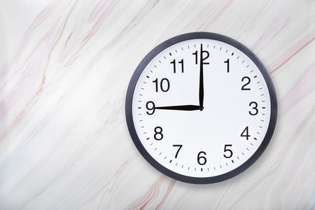Photo for Wall clock show nine oclock on marble texture. Office clock show 9pm or 9am on marble texture with natural pattern - Royalty Free Image